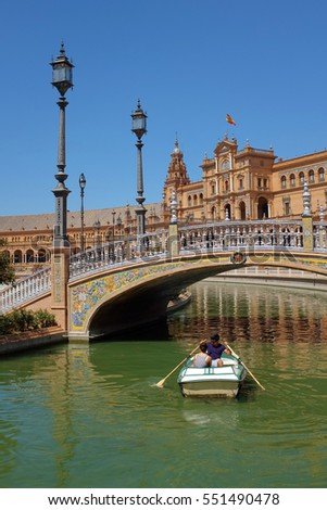 Seville, Spain - 19 August 2016. A couple is row-boating in the canals of Plaza de Spa�±a in Seville, Spain.