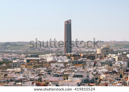 SEVILLE, SPAIN - CIRCA MARCH 2015: Rooftop view of Seville city, with the skyscraper Seville Tower, as seen from the Giralda (bell tower) of Seville Cathedral.