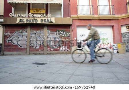 SEVILLE, SPAIN-CIRCA NOVEMBER 2010 : In the country's southern section of Andalucia is plagued with unemployment and decrepit buildings, despite efforts of small businesspeople. - stock photo