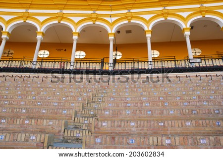 SEVILLE, SPAIN - JANUARY 31: Seville bullring  on January 31, 2012 in Seville, Spain. It is considered to be one of the finest in Spain and is one of the oldest and most important in the world - stock photo