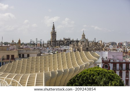 Seville, Spain - June 19: Metropol Parasol in Seville, Spain on June 19, 2014. This large wooden structure, designed by J. Mayer-Hermann, is made from bonded timber with a polyurethane coating.