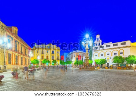 Seville, Spain -June 09, 2017 : Square Virgin of the Kings (Plaza Virgen de los Reyes) and monument of Fuente Farola front of Cathedral of Saint Mary of the See, better known as Seville Cathedral.