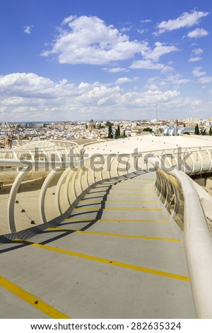 SEVILLE, SPAIN - MAY 2014: Panoramic view in the top of Metropol Parasol in Plaza de la Encarnacion on 31 of May 2014 in Sevilla,Spain. A new Seville Market Hall and attractive destination. - stock photo