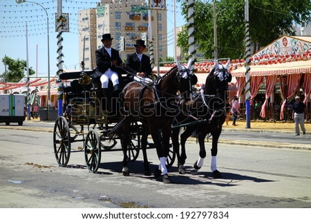 SEVILLE, SPAIN - MAY 11: The carriages at the Seville's April Fair on Seville (Feria de Abril de Sevilla), on May 11, 2014 in Seville, Spain.  - stock photo