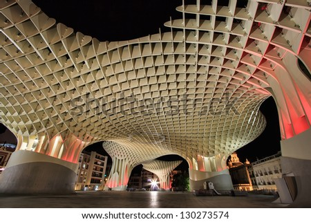 SEVILLE, SPAIN - NOV 19: Metropol Parasol in Plaza de la Encarnacion on November 19, 2012 in Seville, Spain. J. Mayer H. architects, it is made from bonded timber with a polyurethane coating. - stock photo