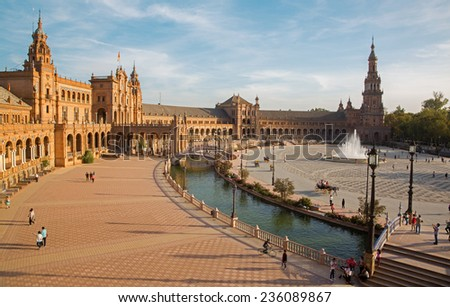 SEVILLE, SPAIN - OCTOBER 27, 2014: Plaza de Espana square designed by Anibal Gonzalez (1920s) in Art Deco and Neo-Mudejar style.