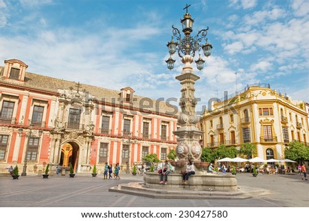 SEVILLE, SPAIN - OCTOBER 28, 2014: Plaza del Triumfo and Palacio arzobispal (archiepiscopal palace).
