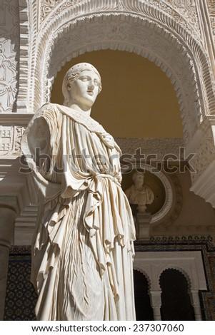 SEVILLE, SPAIN - OCTOBER 28, 2014: The copy of antique statue Pallas Pacifera in the Courtyard of Casa de Pilatos .  - stock photo