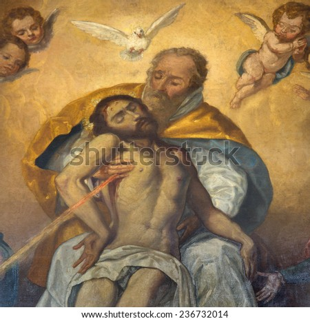 "SEVILLE, SPAIN - OCTOBER 28, 2014: The detail of Holy Trinity from paint ""Souls""  in church Iglesia de San Roque by unknown baroque painter."