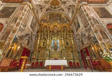 SEVILLE, SPAIN - OCTOBER 29, 2014: The main altar and presbytery of baroque church Basilica del Maria Auxiliadora. - stock photo