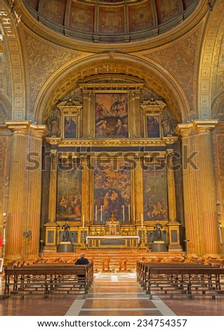 SEVILLE, SPAIN - OCTOBER 29, 2014: The Presbytery and main altar with the central paint the Adoration of shepherds in church Iglesia de la Anunciacion.