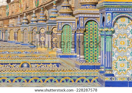 SEVILLE, SPAIN - OCTOBER 28, 2014: The tiled 'Province Alcoves' along the walls of the Plaza de Espana (1920s) by Domingo Prida. - stock photo