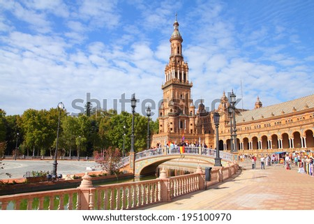 SEVILLE, SPAIN - OCTOBER 12, 2010: Tourists visit Plaza de Espana in Seville, Spain. As of 2009, Spain is the 2nd most visited country in the world.