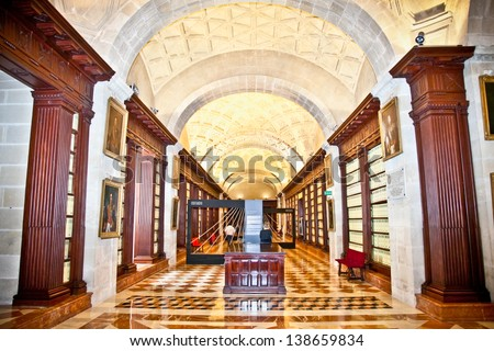 SEVILLE,SPAIN-SEP 11:Inside General Archive of the Indies on Sep 11, 2011 in Seville, Spain.This is example of Spanish Renaissance architecture, registered in 1987 by UNESCO as a World Heritage Site. - stock photo