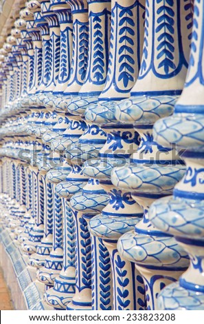 Seville - The ceramic tiled balustrade of the Plaza de Espana.  - stock photo