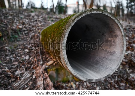 sewage pipe acts on the ground - stock photo