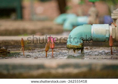 sewage pipe polluting the river - stock photo
