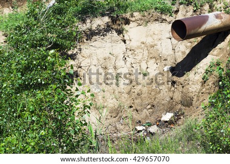 Sewage pipe. The problem of ecology. Dirty wastewater. Pollution. - stock photo