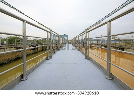 sewage treatment plant aerobic reaction pool channel and handrail, closeup of photo - stock photo