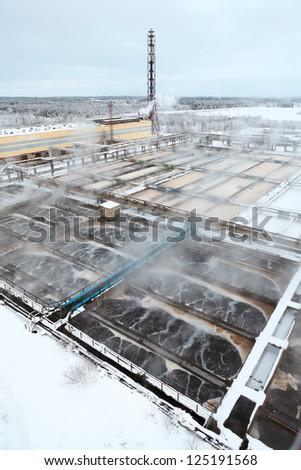 Sewage treatment plant in winter season - stock photo