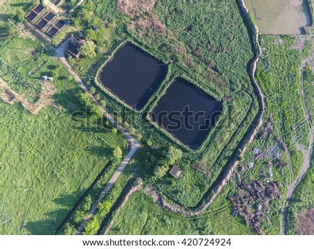 Sewage treatment plant near the city sewage dump. Landfill waste. - stock photo