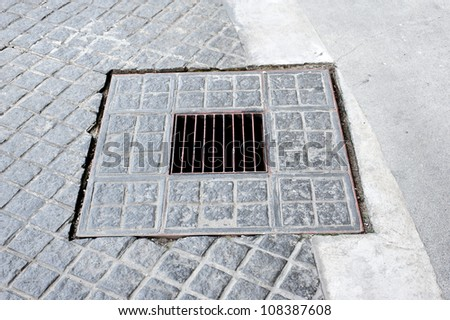 Sewer cover - stock photo