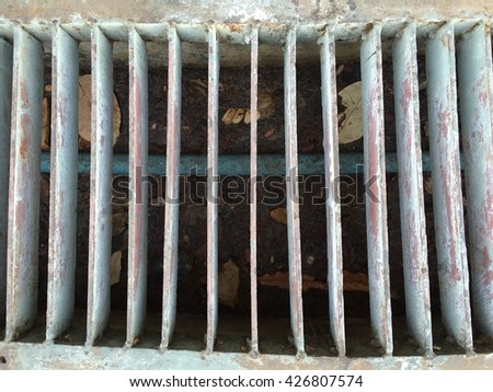 sewer grate water and rain drain - stock photo