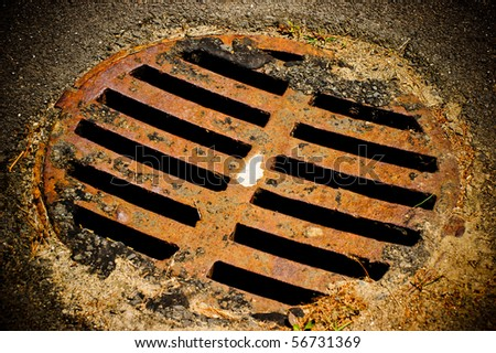 Sewer lid - stock photo