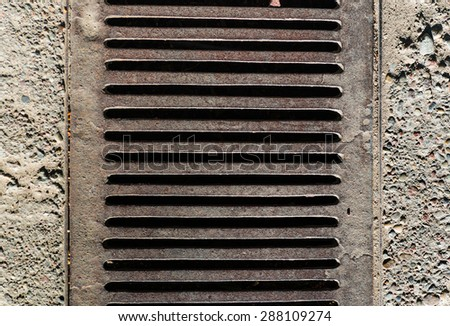 Sewer manhole drain on the urban road texture - stock photo