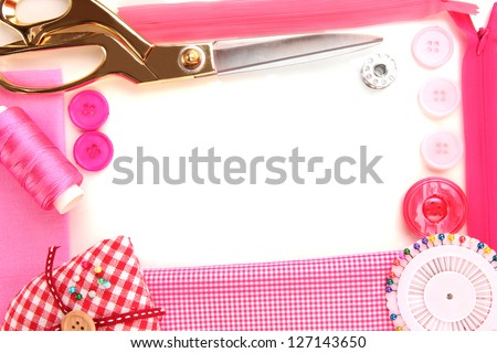 Sewing accessories and fabric close-up - stock photo