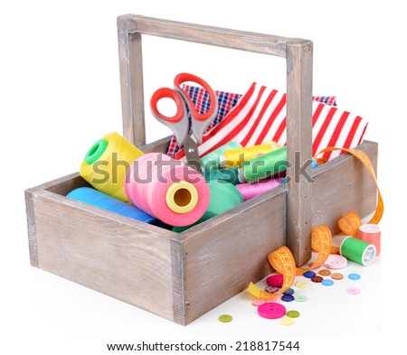 Sewing Accessories in wooden box isolated on white - stock photo