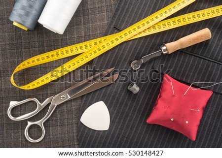 Sewing accessories on a dark background