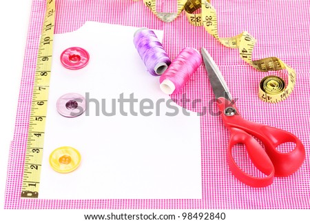 Sewing accessories on fabric isolated on white - stock photo