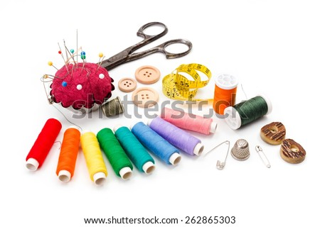 Sewing accessories: scissors, measuring tape, thimbles, colorful threads and buttons