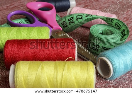 Sewing accessories. Thread , scissors, buttons, and tape measure seamstress.