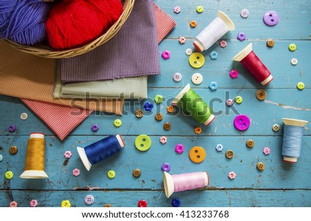 Sewing background. Accessories for needlework on old wooden background.  - stock photo