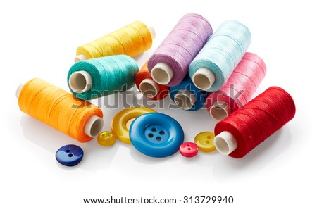 Sewing buttons and thread isolated on white background - stock photo