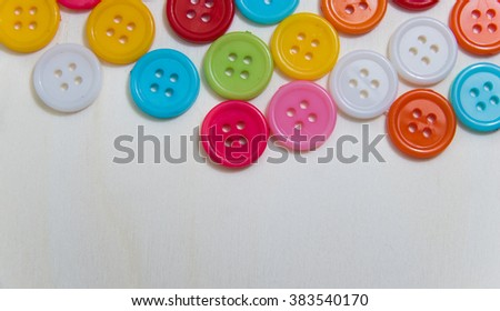 Sewing buttons, Plastic buttons, Colorful buttons on a light background, Buttons close up.Place for text.handmade