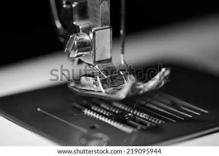 sewing foot in monochrome - stock photo