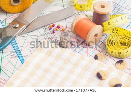 Sewing items checkered textile background
