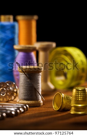 sewing items on brown wooden bards - stock photo