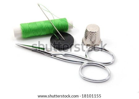 sewing kit isolated on a white background - stock photo