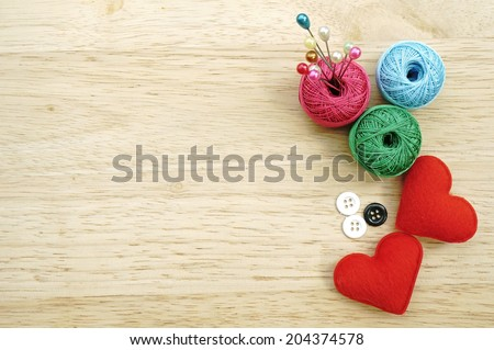 sewing kit, needles, thread and measuring tape - stock photo