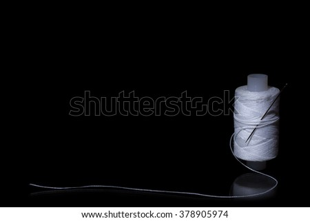 Sewing kit on a black background - stock photo