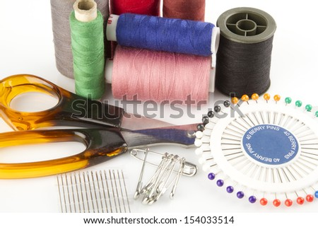 Sewing kit on a white background - stock photo