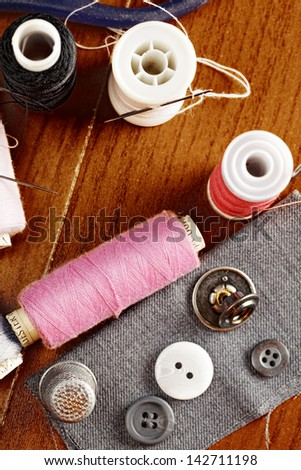 Sewing kit on wooden surface above view - stock photo