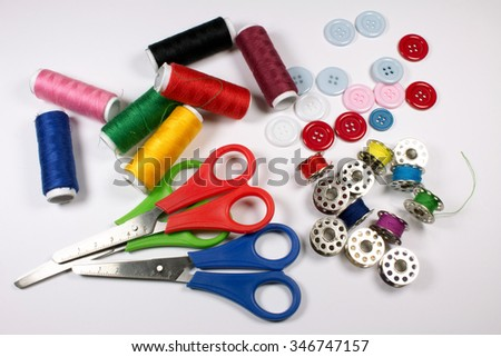 Sewing Kit, Scissors, Threads, and Bobbins isolated.