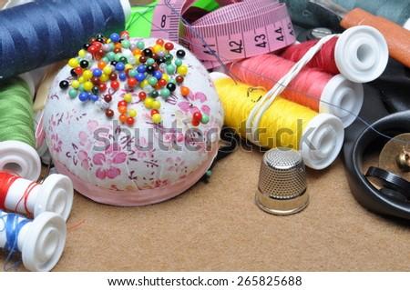 Sewing kit tailor's tools scissors, spool of thread, needle, thimble - stock photo