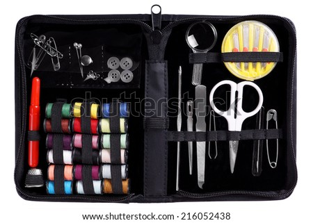 sewing kit with assortment of yarns and needles - stock photo