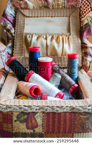 sewing kit with needles and threads - stock photo